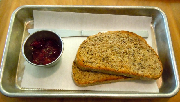 Artisanal toast: ten seed loaf, blueberry jam.